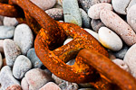Rusty chain on sea-coast