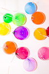 Colourful balloons in white ceiling